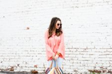 With light blue pants, colorful printed tote bag and brown shoes