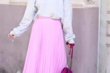 With light gray embellished sweatshirt, purple bag and white sneakers