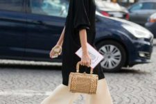With long blouse, beige wide leg trousers and straw bag