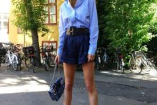 With loose shirt, chain strap bag and lace up heeled shoes