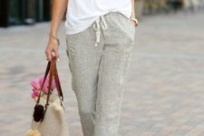 With loose t-shirt, beige tote bag and white sneakers