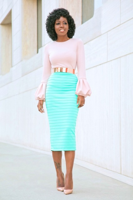 With midi skirt, golden belt and beige pumps