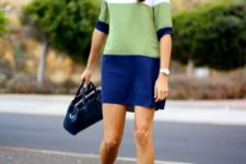 With navy blue velvet ankle boots and bag