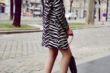 With orange high heels and black bag