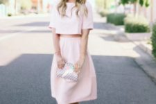 With pale pink A-line skirt, printed clutch and pale pink flat shoes