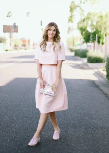 With pale pink A line skirt, printed clutch and pale pink flat shoes