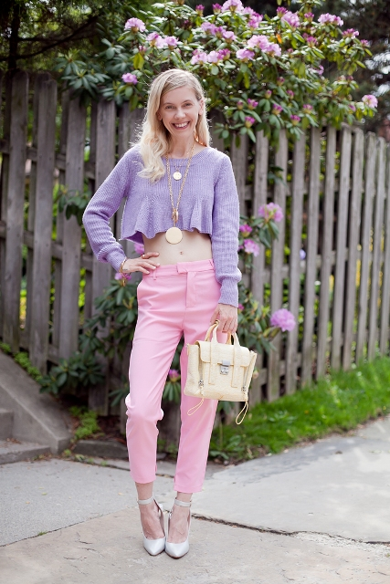 With pink trousers, light yellow bag and ankle strap shoes