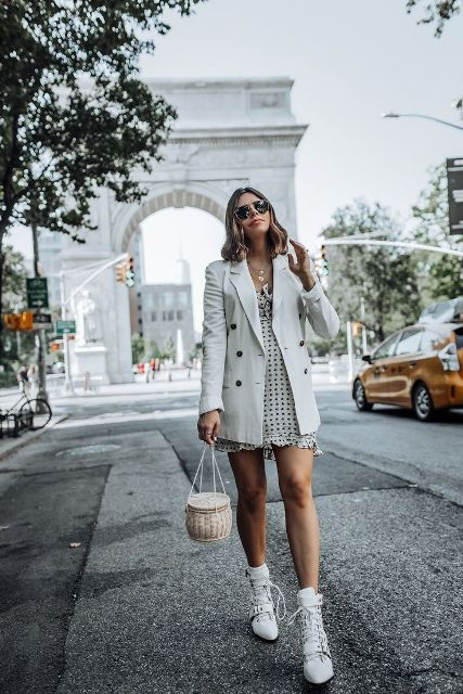 With polka dot ruffled mini dress, bag and lace up boots