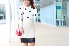 With polka dot shirt, red bag and black shoes