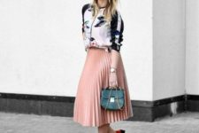 With printed bomber jacket, emerald bag and red low heeled shoes
