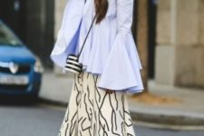 With printed midi skirt, striped bag and black sandals