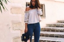 With printed off the shoulder blouse, ruffled jeans and black bag