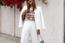 With printed t-shirt, white blazer, gray bag and orange low heeled shoes