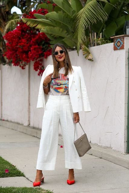 With printed t shirt, white blazer, gray bag and orange low heeled shoes