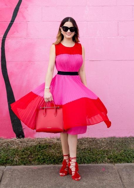 With red leather bag, red tassel lace up heels and sunglasses