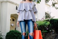 With red tote bag, distressed jeans and embellished shoes