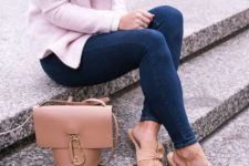 With skinny jeans, pink cardigan and beige leather bag