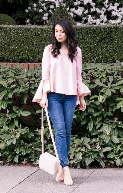 With skinny jeans, white bag and beige shoes