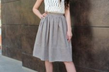 With sleeveless top and white pumps