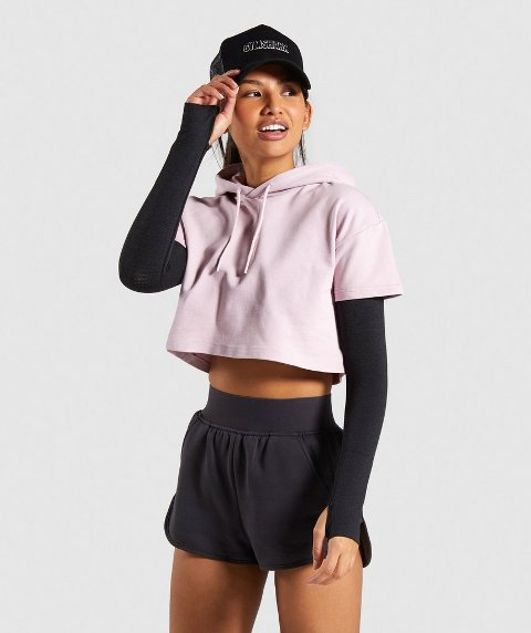 With sporty shorts, long sleeve shirt and cap