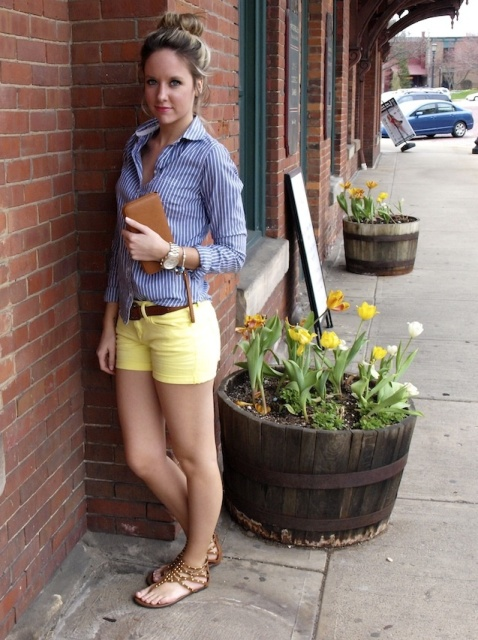 With striped button down shirt, brown clutch and brown flat sandals