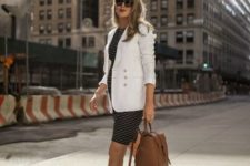 With striped dress, brown backpack and white flats