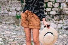 With striped loose shirt, wide brim hat and black flat shoes