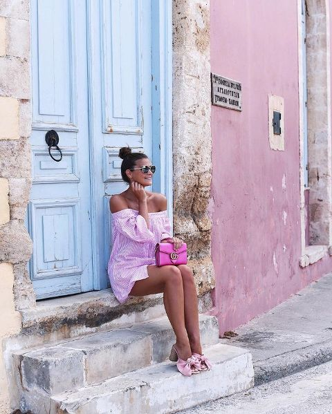 With striped off the shoulder dress and pink bag