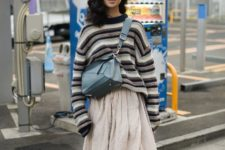 With striped oversized sweater, blue crossbody bag and white sneakers