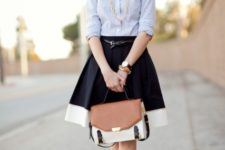 With striped shirt, black pumps and white, brown and black bag
