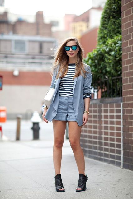 With striped shirt, light blue blazer, white bag and black cutout boots