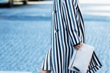 With striped skirt, striped coat and white clutch
