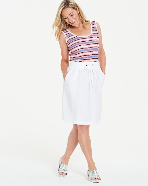 With striped sleeveless top and silver sandals