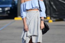 With striped wrap knee-length skirt, black bag and beige ankle strap shoes