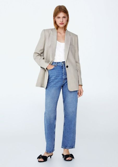 With top, black low heeled mules and jeans
