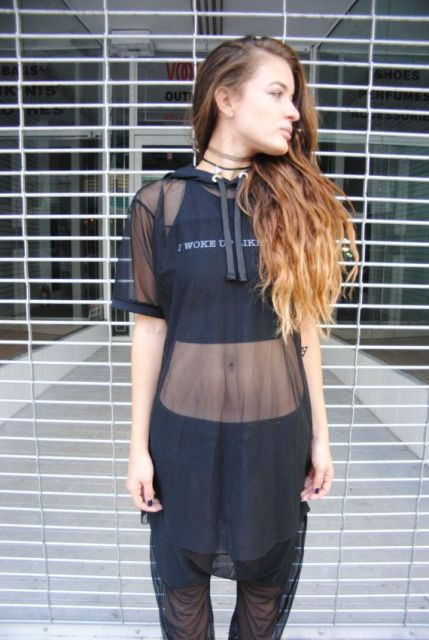 With transparent pants and black crop top