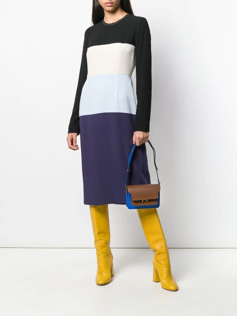 With two colored bag and yellow high boots