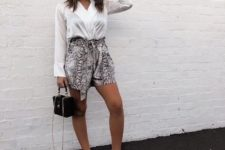 With white V-neck blouse, black bag and white sneakers