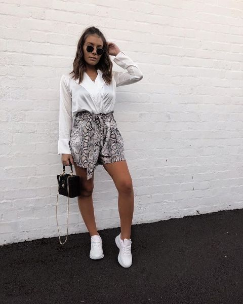 With white V neck blouse, black bag and white sneakers