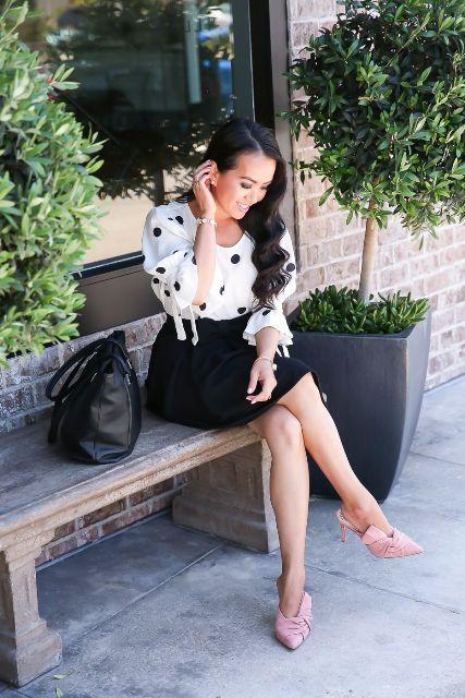 With white and black polka dot shirt, black skirt and black tote bag