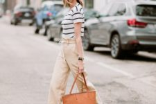 With white and black striped shirt, ankle strap shoes and brown tote bag