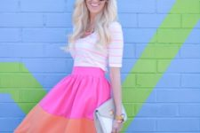 With white and pink striped shirt and clutch