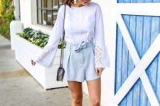 With white bell sleeved blouse, gray bag and pale pink ankle strap shoes