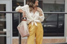 With white blouse, beige high heels and fishnet bag