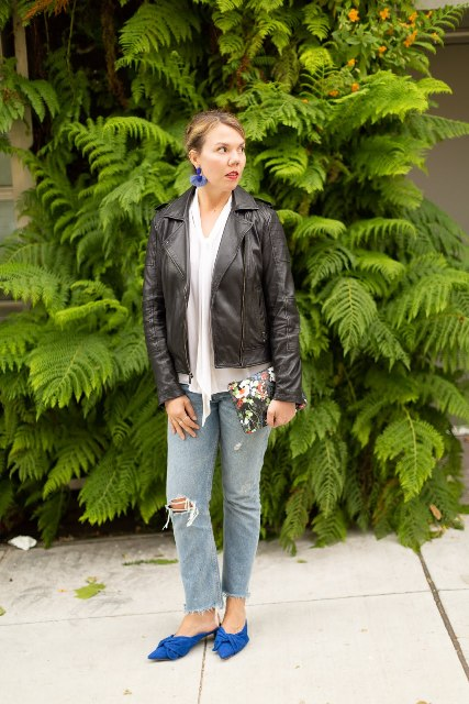 With white blouse, black leather jacket, floral clutch and distressed jeans