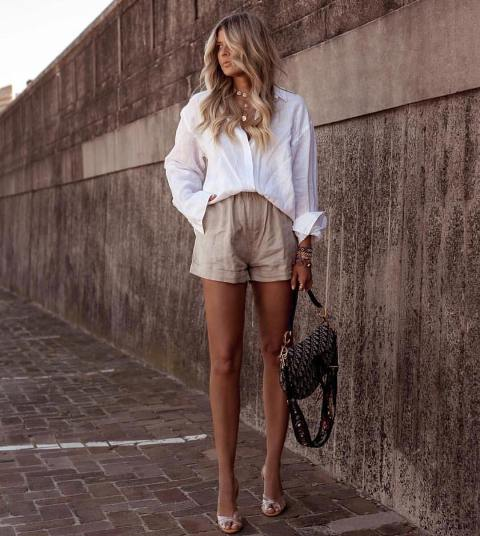 With white button down loose shirt, printed bag and high heels