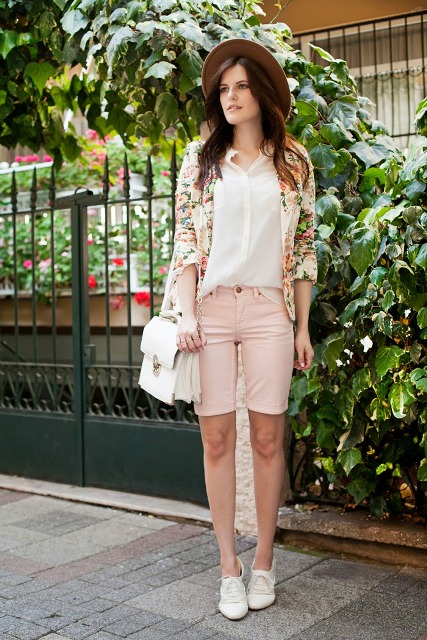 With white button down shirt, floral long cardigan, hat, white chain strap bag and white lace up flat shoes
