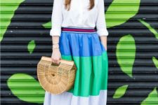 With white button down shirt, straw bag and blue high heels