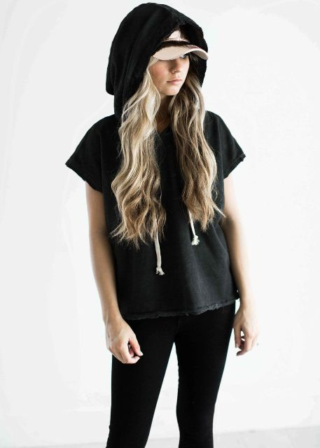With white cap and black skinny pants