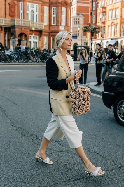 With white culottes, tote bag and three colored blazer